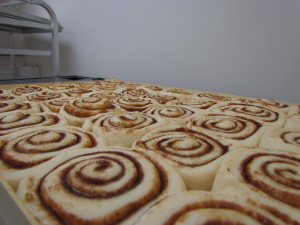 Hand rolled, made from scratch Caramel Cinnamon Buns.  Rising, and ready to go in the oven!